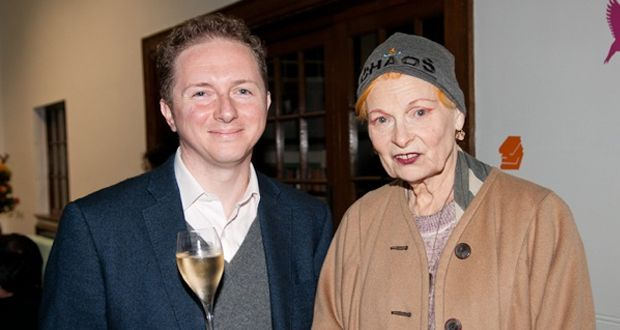 vivienne westwood next to man with a glass of wine