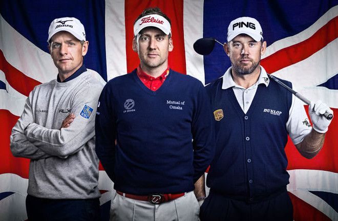 three men dressed in golf gear, one holding a golf club, stood in front of the british flag