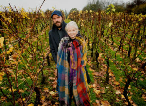 man and woman stood inside a vineyard