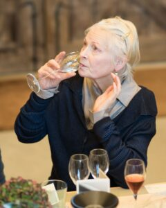 vivienne westwood drinking a glass of wine