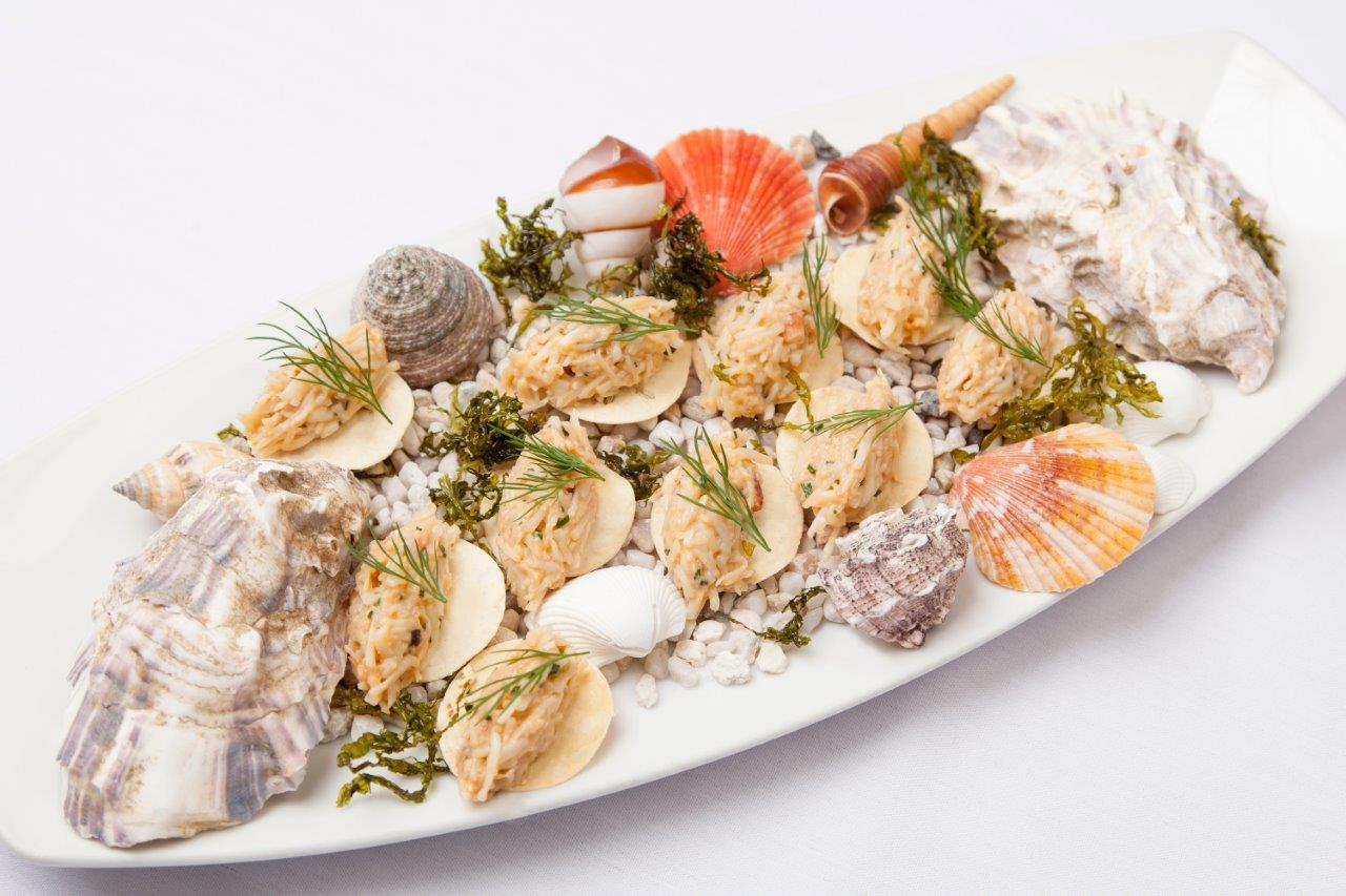 crab and fennel crackers served with served amongst seashells