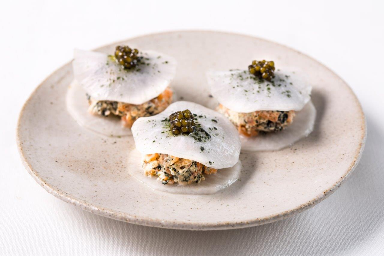 three smoked salmon canapes on a plate