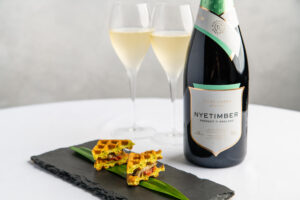 wine bottle and wine glasses with michelin star food