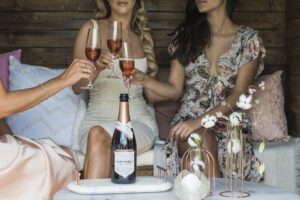 three women enjoying a glass of wine