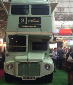 front of green bus at a wine event
