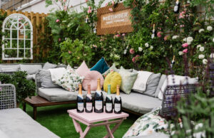 floral rooftop terrace with wine bottles