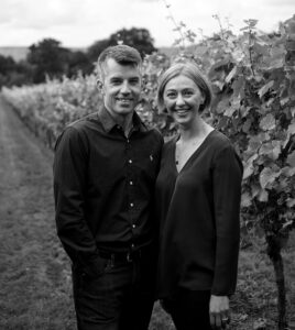 man and woman in vineyard
